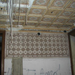 Room with coffered ceiling and graffiti, before restoration