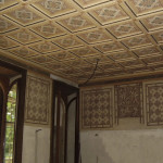 Room with coffered ceiling and graffiti, after restoration